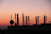 istock Silhouette of GSM transmitters 669118440