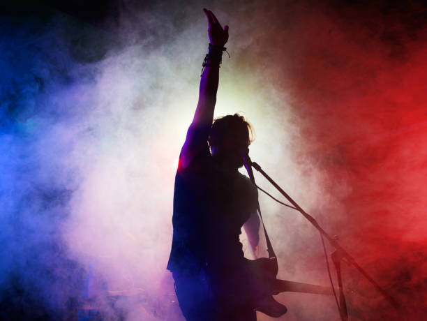silhouette of guitar player on stage. - rock music stock pictures, royalty-free photos & images