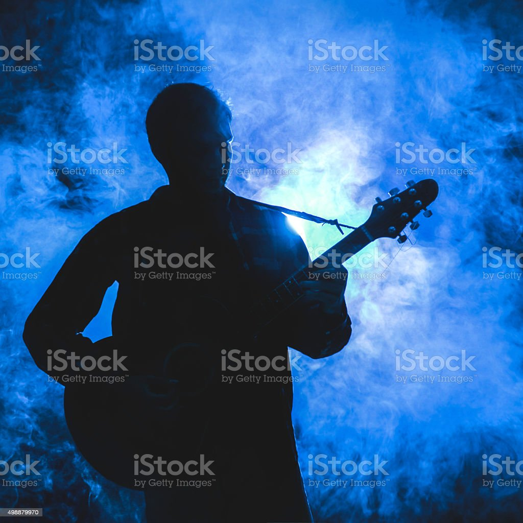 Silhouette of guitarist stock photo