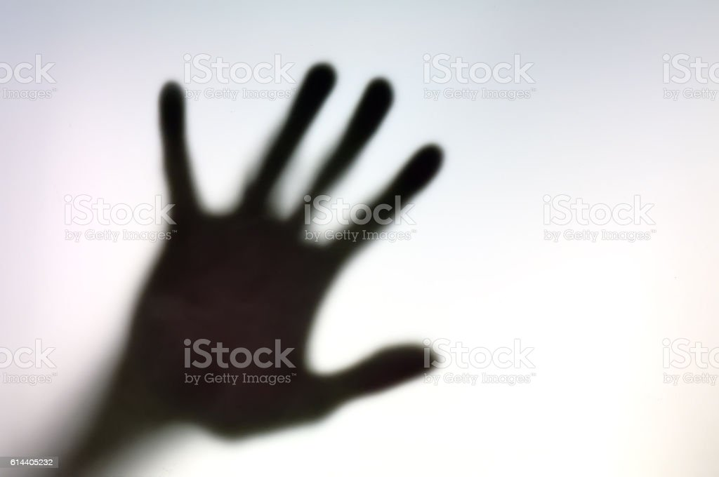 Silhouette of hand on a white surface stock photo