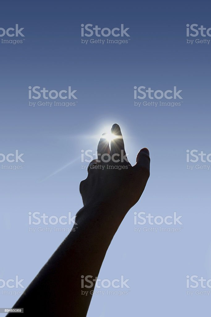 Silhouette of hand sheltering the sun demonstrating future royalty-free stock photo