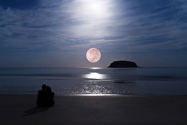 silhouette of happy couple at fullmoonset  horizon over andaman sea - romantic moon stock photos and pictures