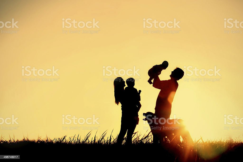 Silhouette of Happy Family and Dog royalty-free stock photo