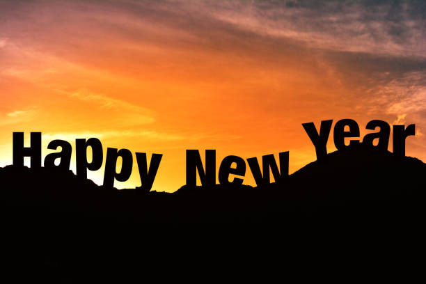 Silhouette of Happy new year in hill station stock photo