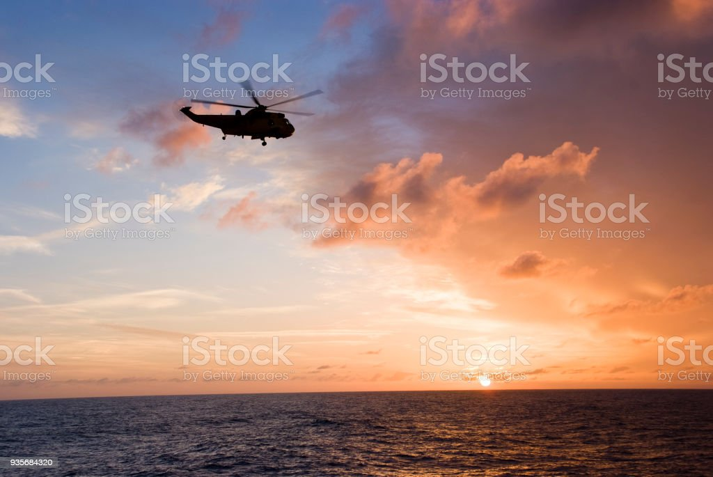 Silhouette of helicopter stock photo