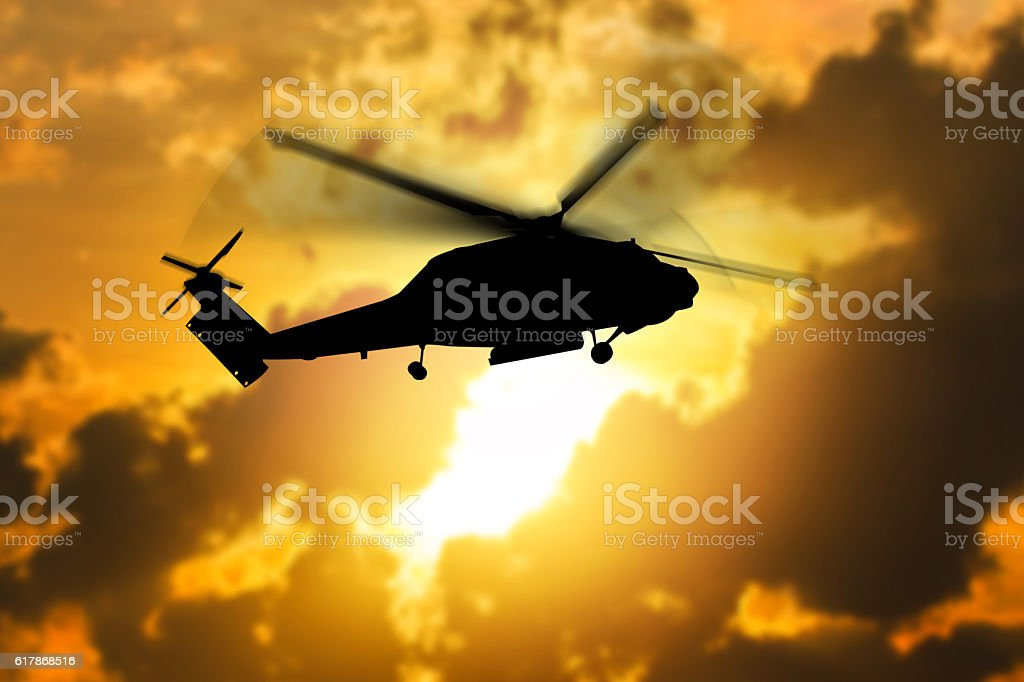 silhouette of helicopter with sunset. stock photo