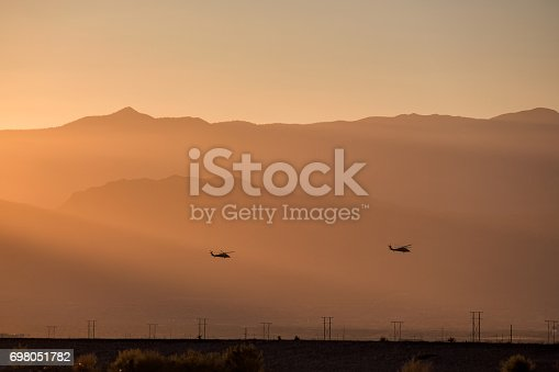 silhouette of small helicopter with sunset.