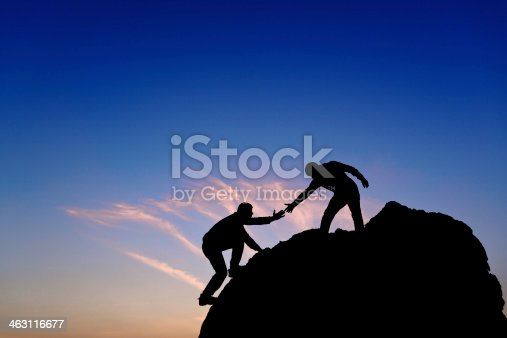 istock Silhouette of helping hand between two climber 463116677