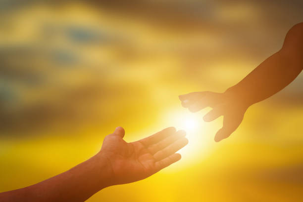 Silhouette of helping hand. stock photo