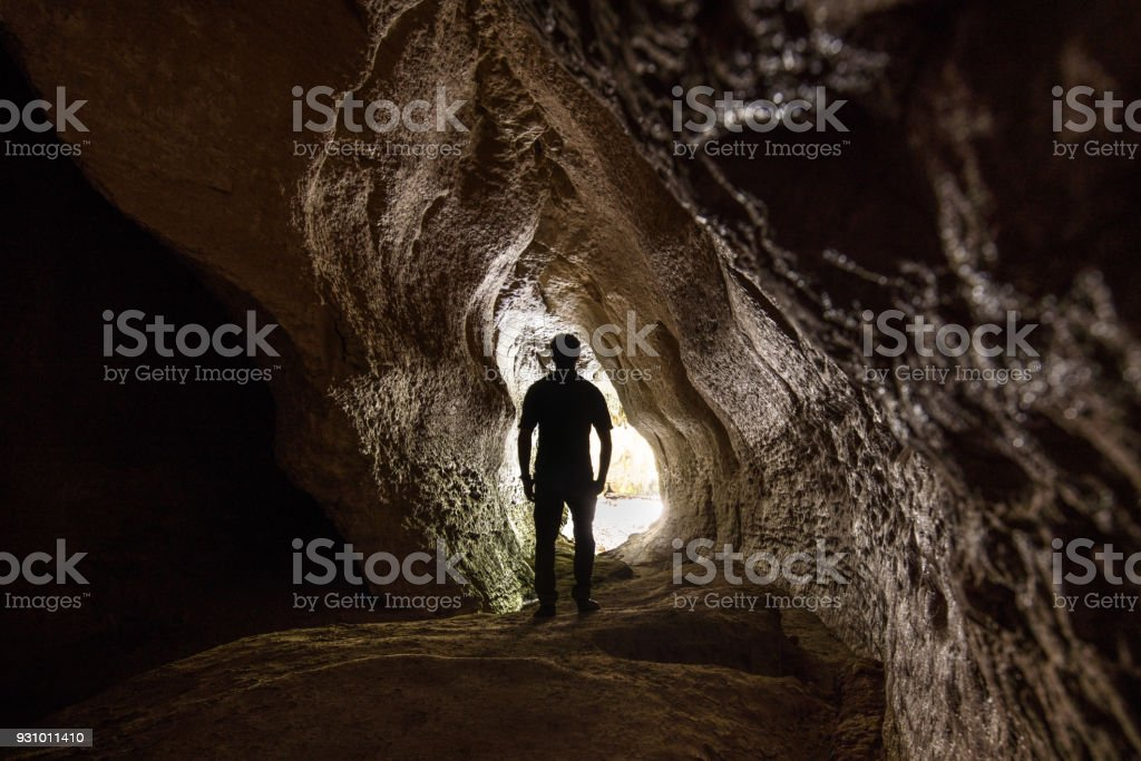 Silhouette of Hiker at Moria Gate Arch, New Zealand stock photo