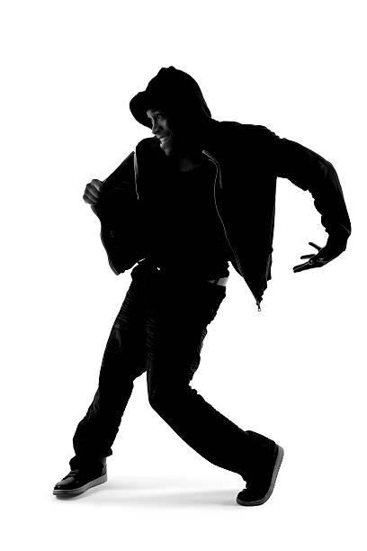 Silhouette of Hip Hop Dancer stock photo