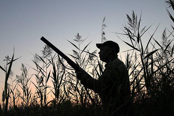 Silhouette of hunter holding gun and preparing to shoot picture id93006523?b=1&k=6&m=93006523&s=612x612&w=0&h=jptnaiwvizkcksfklsjlyzqdpsnfbho1jjgh9irqeau=