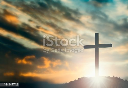 istock Silhouette of Jesus with Cross over sunset concept for religion, worship, Christmas, Easter, Redeemer Thanksgiving prayer and praise 1144447712