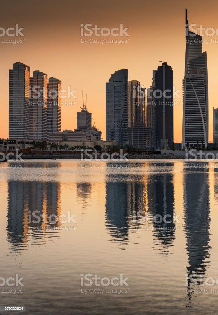 Silhouette of Jumeirah lakes towers at dusk, Dubai, United Arab Emirates stock photo