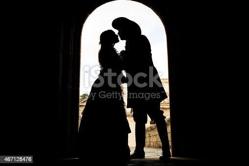 istock silhouette of kissing romeo and juliet 467128476