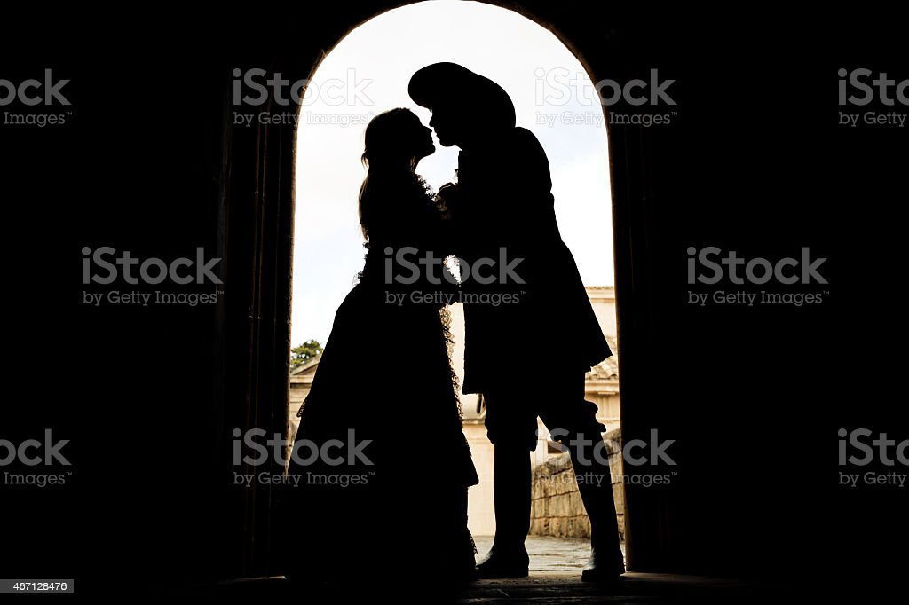 silhouette of kissing romeo and juliet stock photo