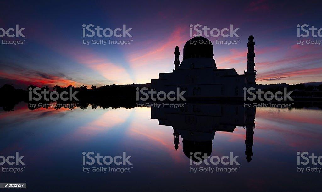 Silhouette of Kota Kinabalu mosque at sunrise stock photo