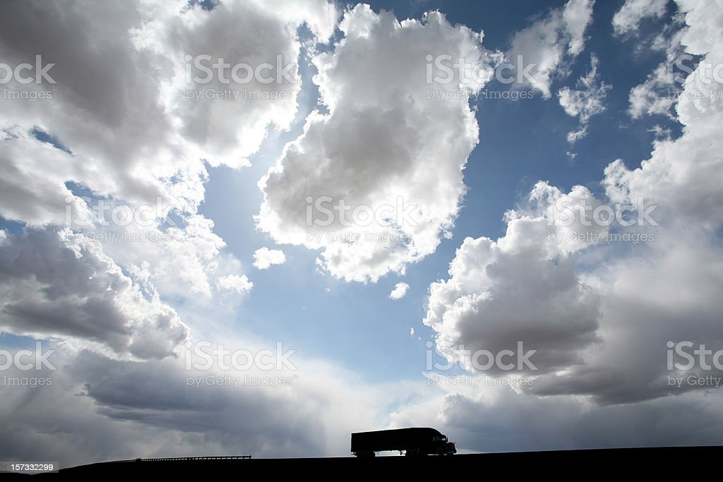 Silhouette of Long Distance Trucking or 18-Wheeler royalty-free stock photo