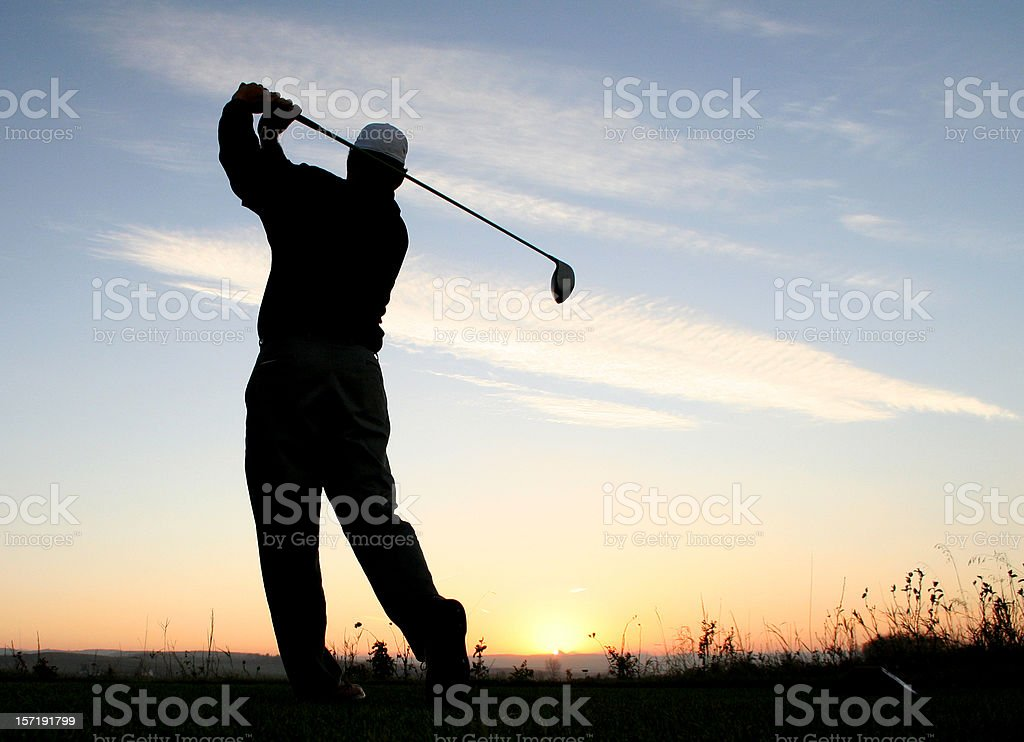 Silhouette of Male Golfer Swinging Rear View royalty-free stock photo