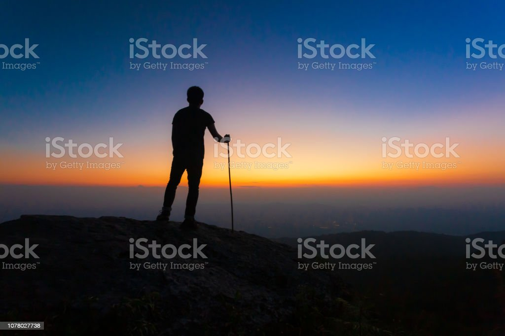 Silhouette of man and beautiful sky. Element of design stock photo