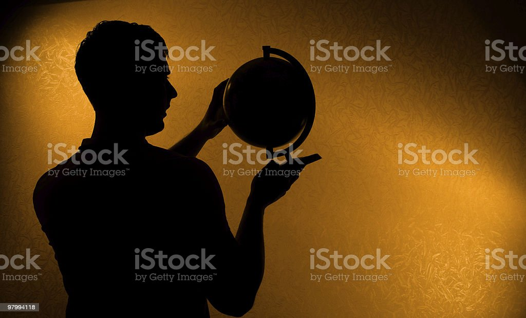 Silhouette of man holding globe royalty-free stock photo