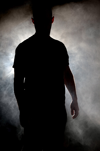 istock Silhouette of man in a cloud of smoke 172285346