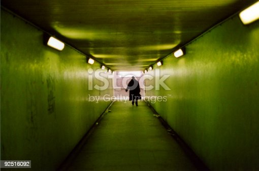 istock Silhouette of man in underpass with greenish light 92516092