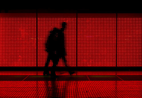 coiuple walking in front of an LED wall