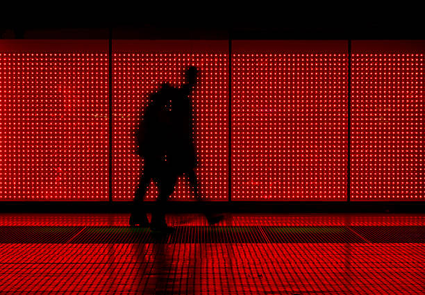 Silhouette of man moving in red background stock photo
