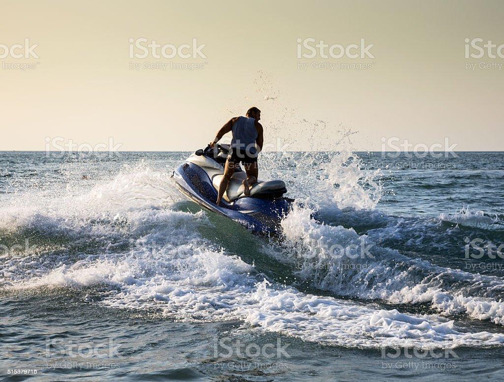 Silhouette of man on jetski at sea stock photo