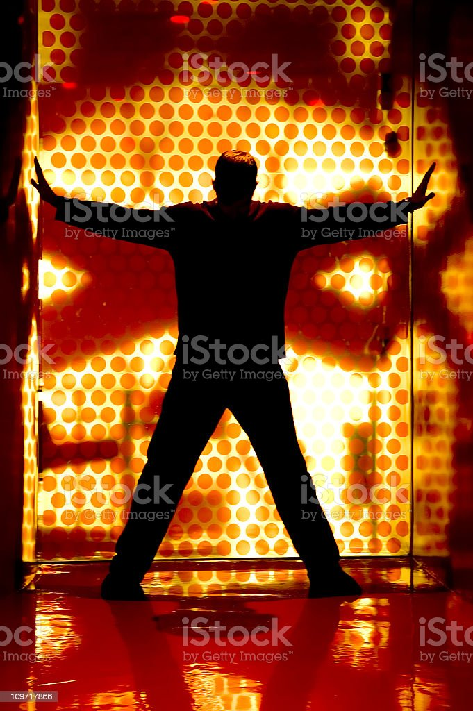 Silhouette of Man Posing in Box with Lights stock photo