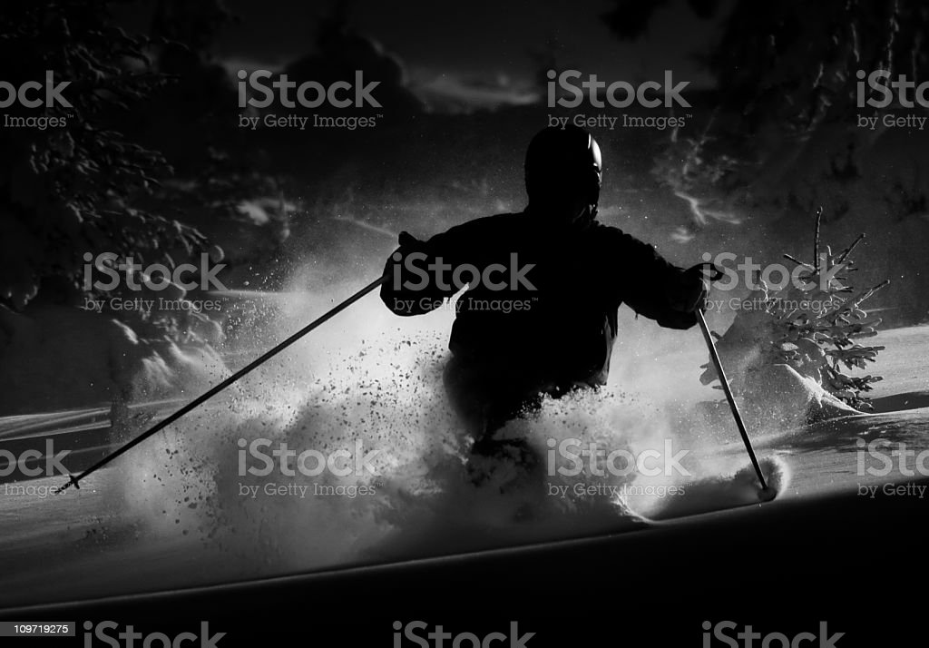 Silhouette of Man Skiing and Carving in Snow royalty-free stock photo