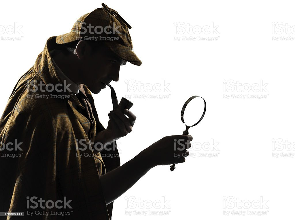 Silhouette of man smoking a cigar holding a magnifying glass stock photo