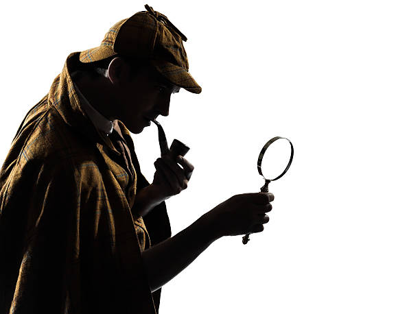 Silhouette of man smoking a cigar holding a magnifying glass sherlock holmes silhouette in studio on white background detective stock pictures, royalty-free photos & images