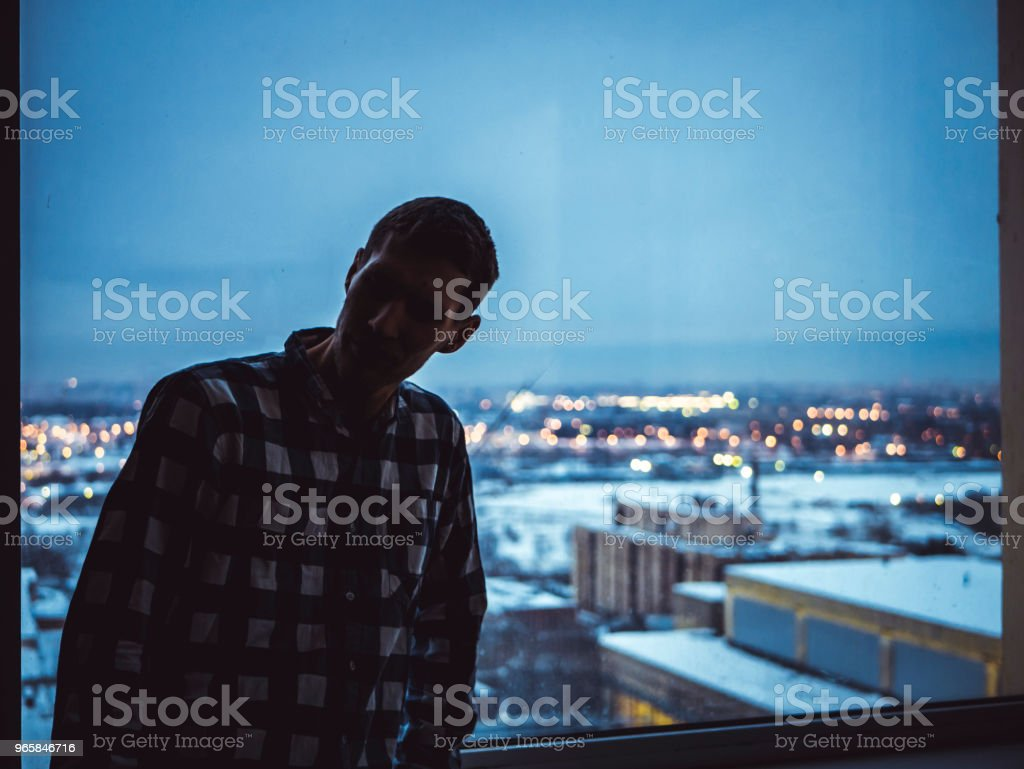 silhouette of man standing near the window - Стоковые фото Архитектура роялти-фри