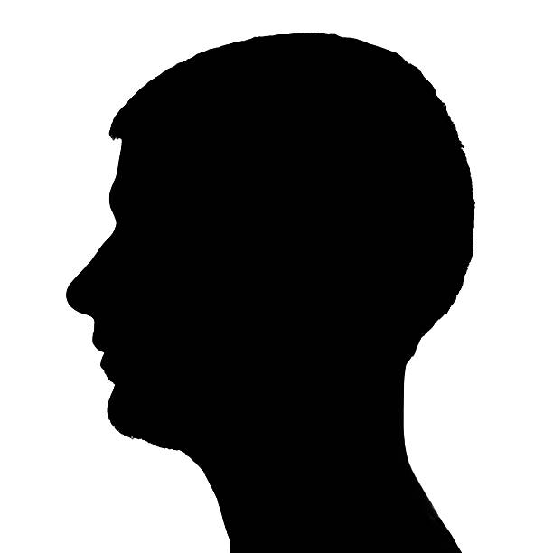 Silhouette of Man's Face in Profile stock photo