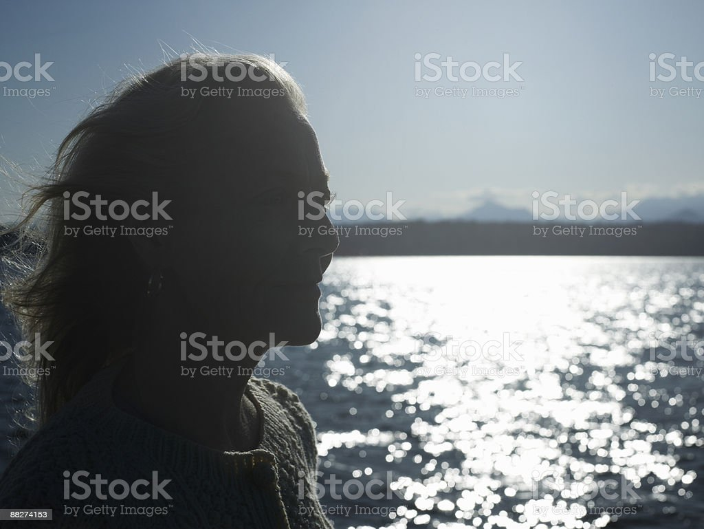 Silhouette of mature woman on sailboat royalty-free stock photo