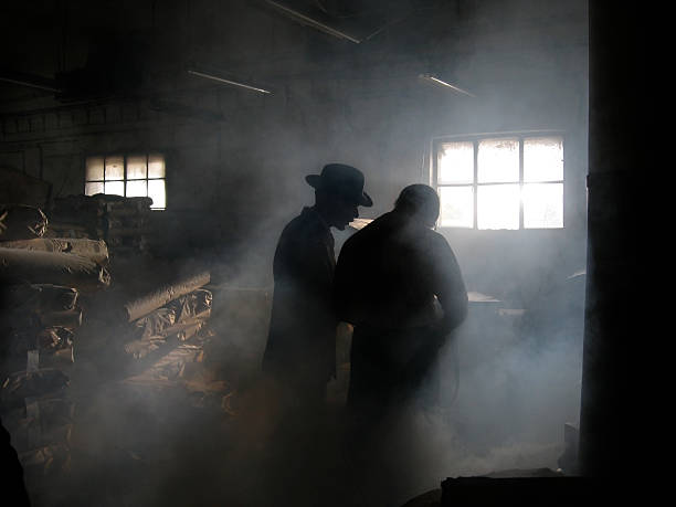 Silhouette of Men in Smoke  detective stock pictures, royalty-free photos & images
