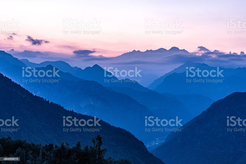 Silhouette of Monte Rosa, Italian Alps mountains misty landscape stock photo