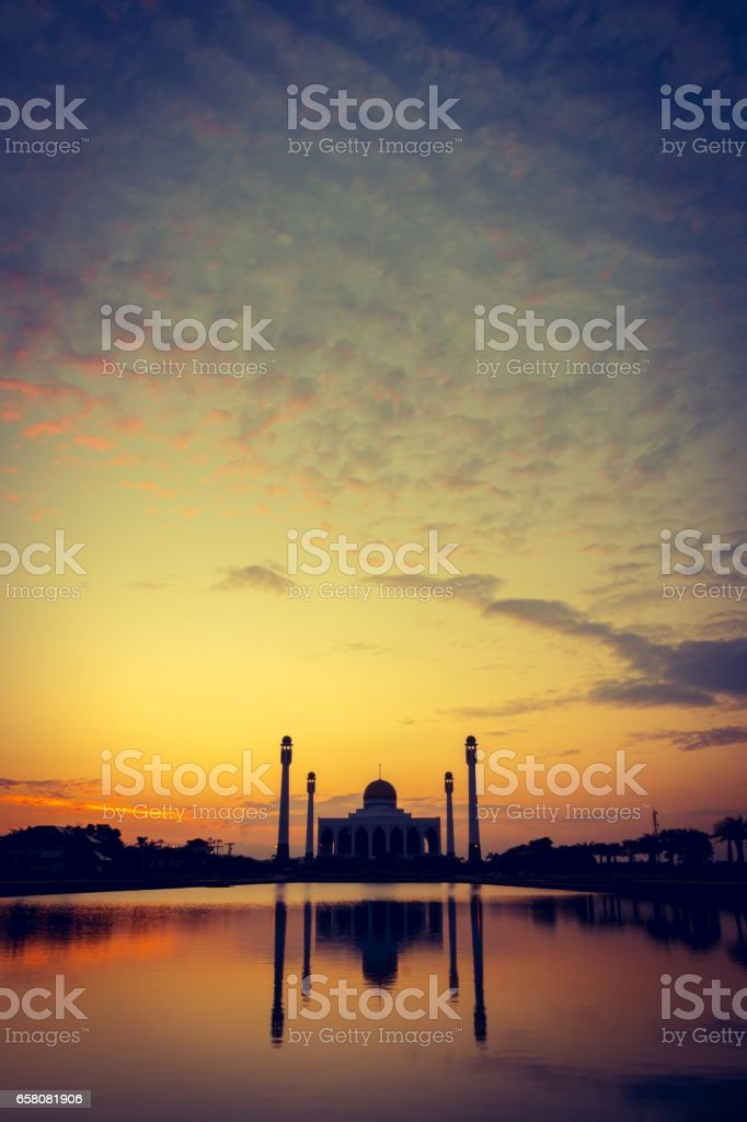 Silhouette of mosque at sunset stock photo