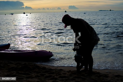silhouette of mother and baby on the beach
