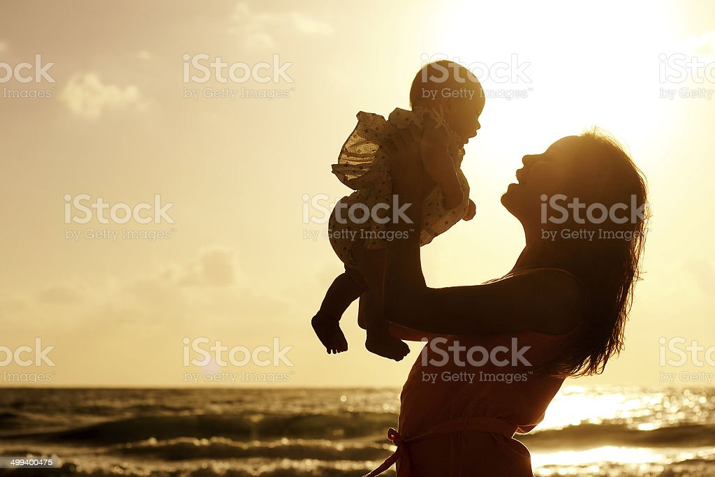 Silhouette of mother and baby royalty-free stock photo