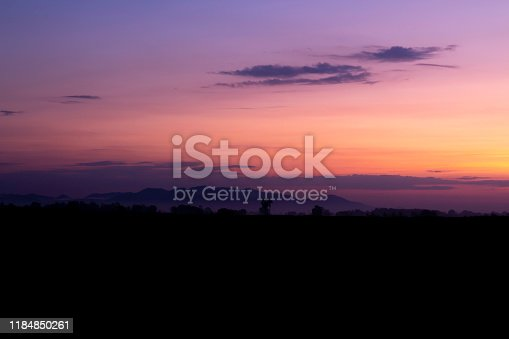 540203788 istock photo Silhouette of mountain and the pink sky in the morning 1184850261