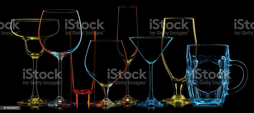Silhouette of multicolor different glasses stock photo