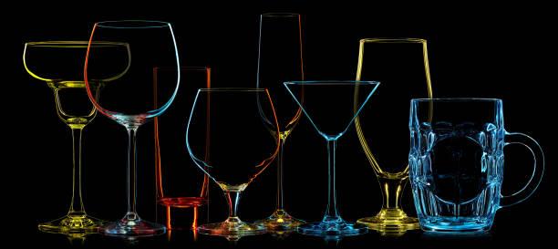 silhouette von multicolor verschiedene gläser - neon partylebensmittel stock-fotos und bilder