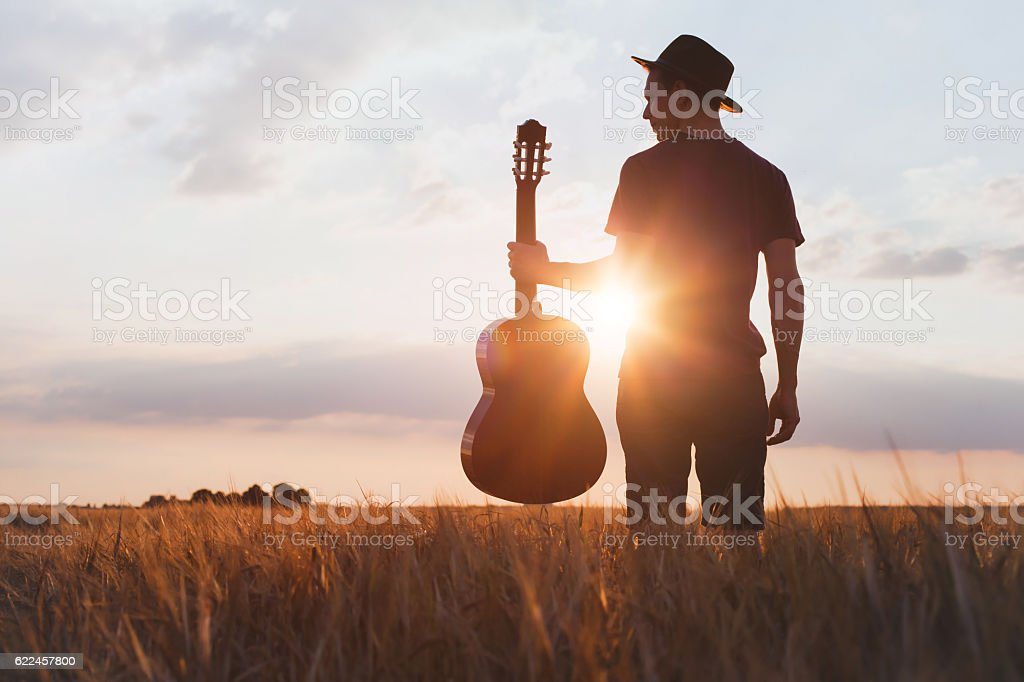silhouette of musician with guitar, music festival stock photo