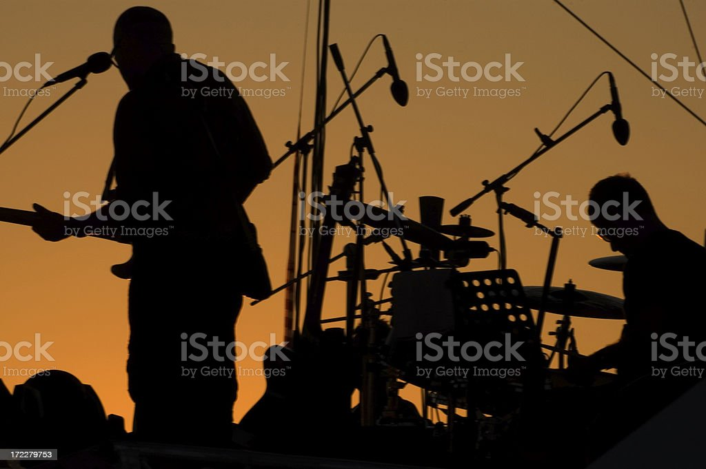silhouette of musicians stock photo