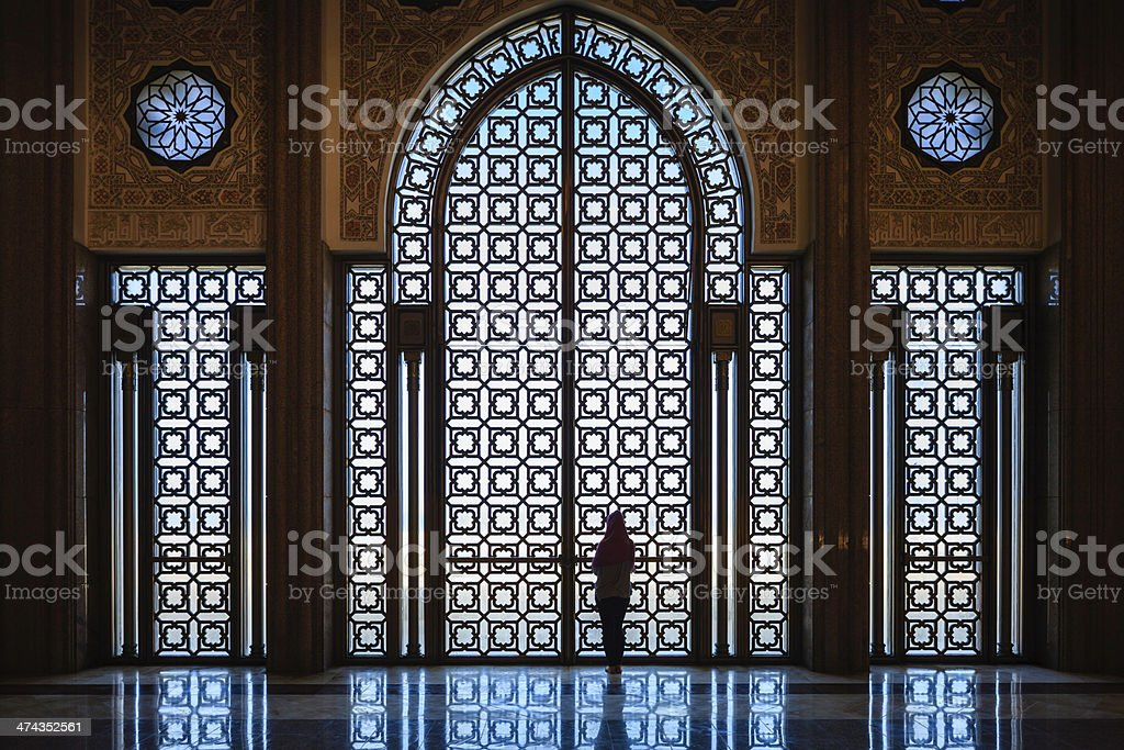 Silhouette of muslim woman inside the mosque stock photo
