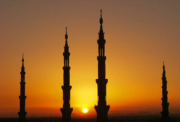 Silhouette of Nabawi mosque minarets, AL Madinah, Arabia Silhouette of minarets of Nabawi mosque, Medina, Saudi Arabia minaret stock pictures, royalty-free photos & images