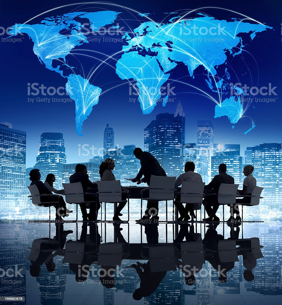 Silhouette of office meeting on globe background royalty-free stock photo